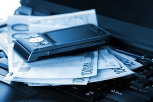 Mobiel Phone, banknotes and laptop